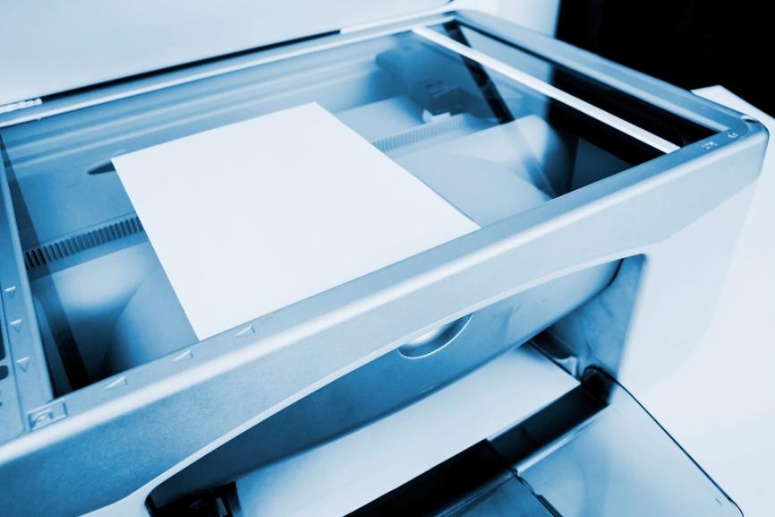 Place hard copy document on desktop scanner